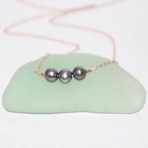 Rose gold pearl necklace (looks like Tahitian)